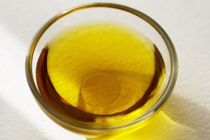 Yellow oil in a glass dish